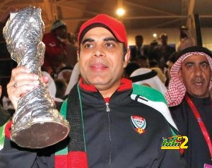 UAE's head coach Mahdi Ali holds the trophy after winning their Gulf Cup final match against Iraq in Isa Town, January 18, 2013.  REUTERS/Fadi Al-Assaad (BAHRAIN - Tags: SPORT SOCCER)